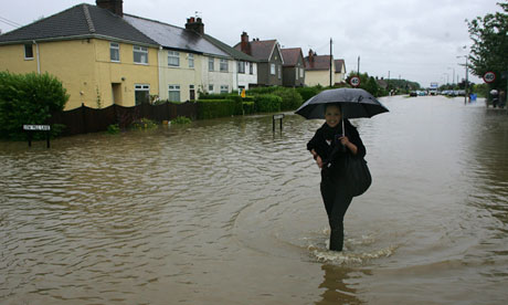 Woman walking through floodwater