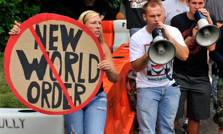 Protestors with placards and megaphones at Bilderberg 2012