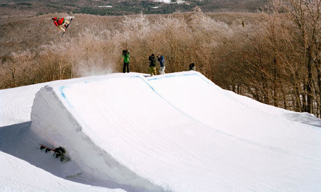 A snowboarder going over a jump, Stratton, Vermont, USA. Image shot 2009. Exact date unknown.