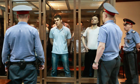 The 'Bolotnaya case' defendants in their glass box at the trial in Moscow.