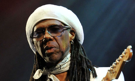 Nile Rodgers on stage with guitar at Glastonbury festival