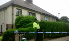 A police officer outside house on Prospect Mount, Shipley, where Louisa Denby was found dead