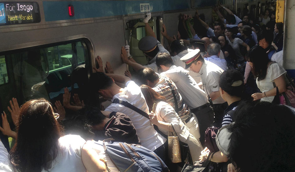 Japanese Push Train Carriage to Rescue Woman
