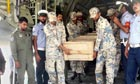 Pakistani air force officers carry a coffin