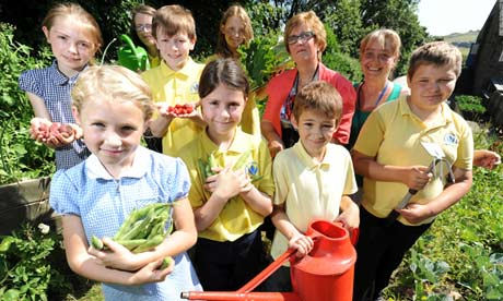 Pupils and staff in the vegetable garden at Haworth primary school.