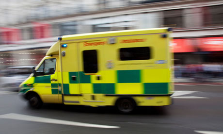 Ambulance passes at high speed in central London.