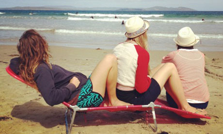 Instagram photo of three sisters sharing seat at beach