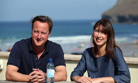 Britain's Prime Minister David Cameron and his wife Samantha pose for a photograph
