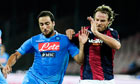 Gonzalo Higuain and Bologna's Daniele Natali vie for the ball