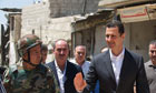 Bashar al-Assad inspects a unit of the armed forces