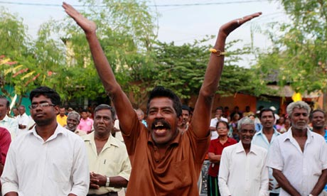 man cheers at a rally in Jaffna