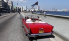 Tourists ride a 1957 Chevrolet Bel Air convertible on Havana's seafront boulevard 'El Malecón'.