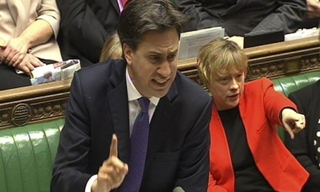 Labour party leader Ed Miliband speaks as Angela Eagle points during Prime Minister's Questions in t