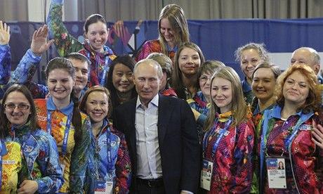 Vladimir Putin poses with Sochi Winter Olympics volunteers