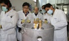 IAEA inspectors watch as Iranian scientists