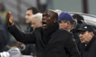 The new Milan coach Clarence Seedorf gestures