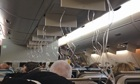 Oxygen masks hang from ceiling of Singapore Airlines Airbus A380