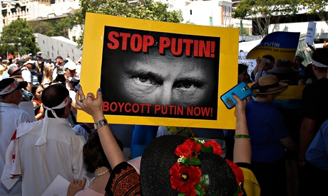 Anti-Putin protests in Brisbane, Australia. The Russian leader has defended his stance over Ukraine.