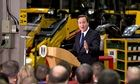 David Cameron gives speech with JCB diggers in background