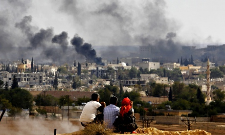 Refugees from Kobani watch the Syrian town during fighting between Isis and peshmerga forces.