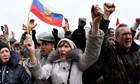 Pro-Russian activists wave a Russian flag at a rally in Donetsk, eastern Ukraine.