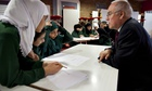 Sir Michael Wilshaw talks to pupils at Park View business and enterprise school in Birmingham