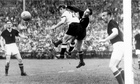 Gyula Grosics and German striker Hans Schäfer tangle during the 1954 World Cup final.