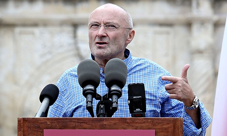 Phil Collins in front of a microphone