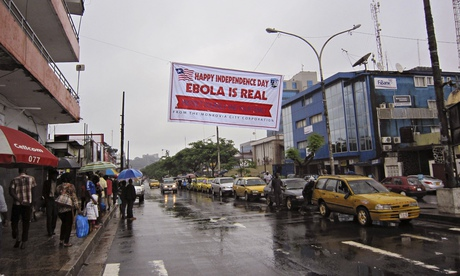 Banner in Monrovia, Liberia, warns people to be cautious about the ebola virus
