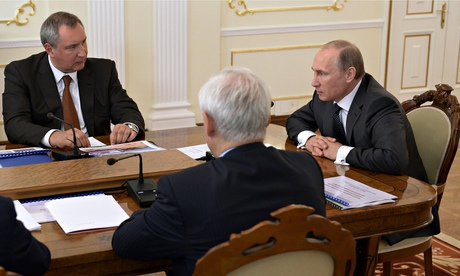 Vladimir Putin and deputy prime minister Dmitry Rogozin, left