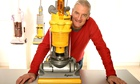 James Dyson with a Dyson vacuum cleaner