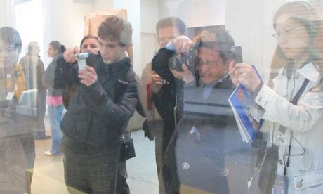 visitors photograph the Rosetta stone