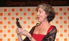 Barbara Kingsolver  with her trophy for the Orange prize for fiction in 2010
