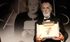 Michael Haneke collects the Palme d'Or for Amour at Cannes 2012
