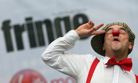 Edinburgh fringe festival act performs on the Royal Mile