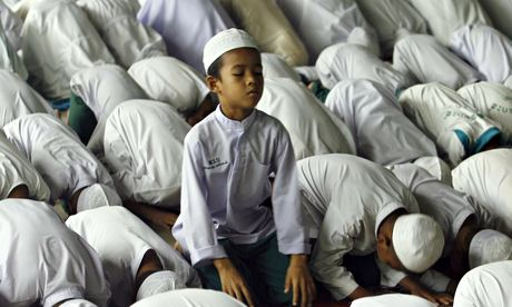 Muslim orphan praying during Ramadan, Thailand