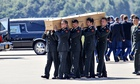 Coffin carried, MH17 victim at Eindhoven, Netherlands