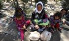 Yazidi woman and children resting, Syria border