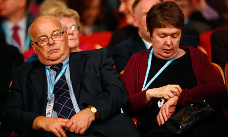 A delegate sleeps as Cabinet Office minister Francis Maude speaks at the Tory party conference