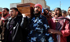 Free Syrian Army fighters carry a comrade killed by militias loyal to Bashar Assad in Idlib