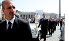 Pope Benedict XVI and bodyguards pass through St. Peter's Square, Vatican, Rome, Italy - 30 May 2012