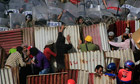 Protesters take shelter during brick throwing clashes outside the Ministry of Defence in Cairo,