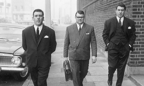 East End gangsters Reggie, left, and Ronnie Kray on their way to court in London in 1965.