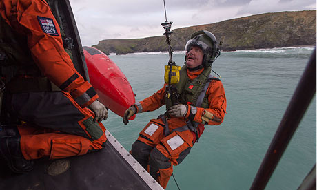 Warrant Officer aircrewman Ian Zippy Thompson is winched out of a Sea King helicopter over Cornwall