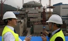 George Osborne and Guo Liming, of Taishan Nuclear Power, in front of a nuclear reactor in Guangdong