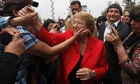 Chile's Michelle Bachelet meets supporters in San Ramón, Santiago, after the first round of voting