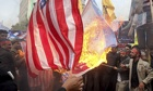 Iranians burning US flags during a demonstration to mark the anniversary of 1979 US embassy takeover