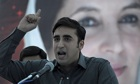 Bilawal Bhutto Zardari at a rally before a poster of his mother, assassinated premier Benazir Bhutto