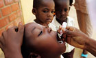 A boy is vaccinated against polio in Kano, Nigeria
