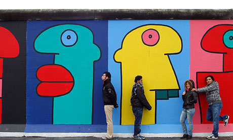 Berlin wall 39 s most iconic paintings under threat from for Berlin wall mural